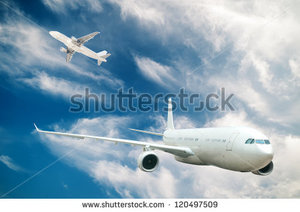 stock-photo-large-passenger-plane-flying-in-the-blue-sky-120497509.jpg